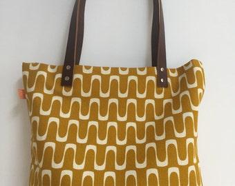 A stunning mustard geometrical bag
