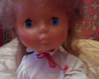 Vintage doll. Made in USSR.On the back there is a stigma.