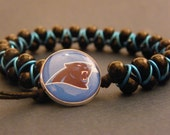 Goddess Bracelet - Black Glass Beads with Panthers Resin Button