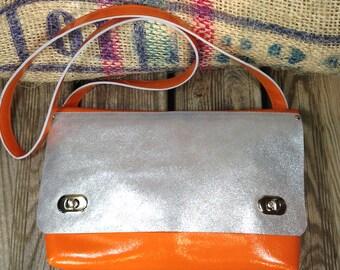 Woman orange vintage leather handbag