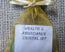 Wealth and Abundance Crystal Set includes 3 stones, helpful information and Organza Bag