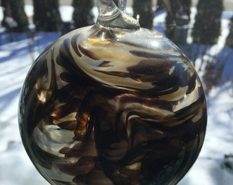 Black, ivory, and amber ornament