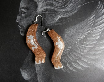 earrings, wood, lion, medieval style drawing, dragon drawing end medieval style, lion and Dragon