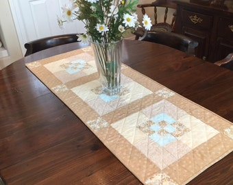 Soft neutrals quilted table runner.
