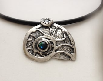 "PMC fine silver ""ammonite"" necklace  with bluish green dicrotic glass stone."