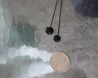 Two black glass topped vintage hat pins