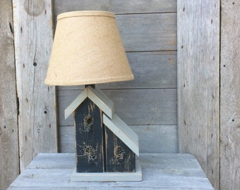 Rustic birdhouse lamp. Whimsical yet functional artwork, a unique accent piece for any decor. Brighten your world with flair.