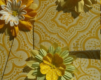 Yellow and gold  flower cards on patterned and textured background. Moroccan print.