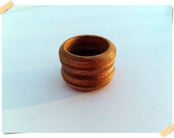 Wooden hand crafted ring made of okume playwood,simple design, 100% natural, ring size 9.