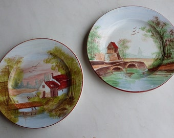 A pair of hand painted Creil et Montereau plates, circa 1890's. Vintage French rural mill scene plates.