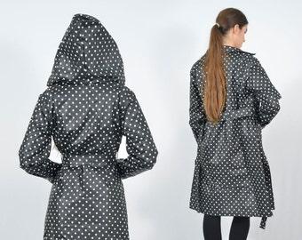 A waxed waterproof raincoat - Black with white polka dots
