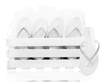 30 pairs of diamanté jelly flip flops presented in a beautiful crate