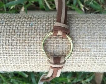 Gold ring brown-beige cord bracelet