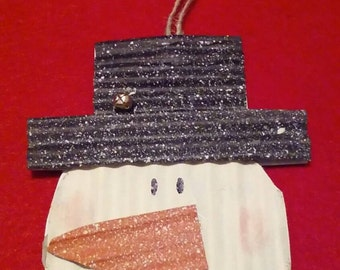 Corrugated cardboard snowman ornament.