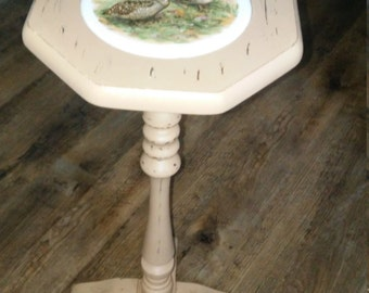 a vintage wood tall side table with a ceramic woodcock scene upcycled in