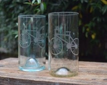 Set of two upcycled wine bottle glasses with custom design