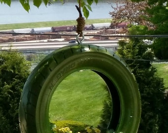 Tire swing hanging planter