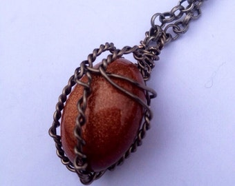 Reiki infused Goldstone Wire wrapped necklace