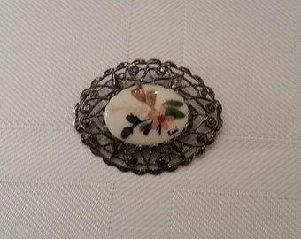 Hand painted porcelain floral brooch signed by Evi