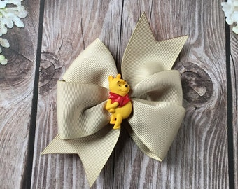 Winnie the Pooh pinwheel hair bow on beige ribbon with Pooh in the center on fully lined alligator clip