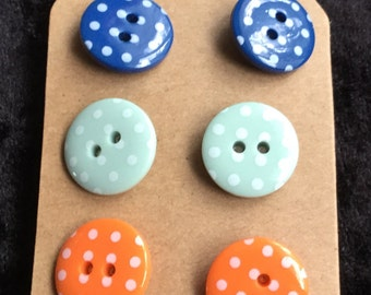 Trio of button earrings