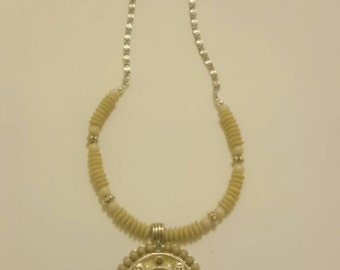 Beaded necklace with medallion