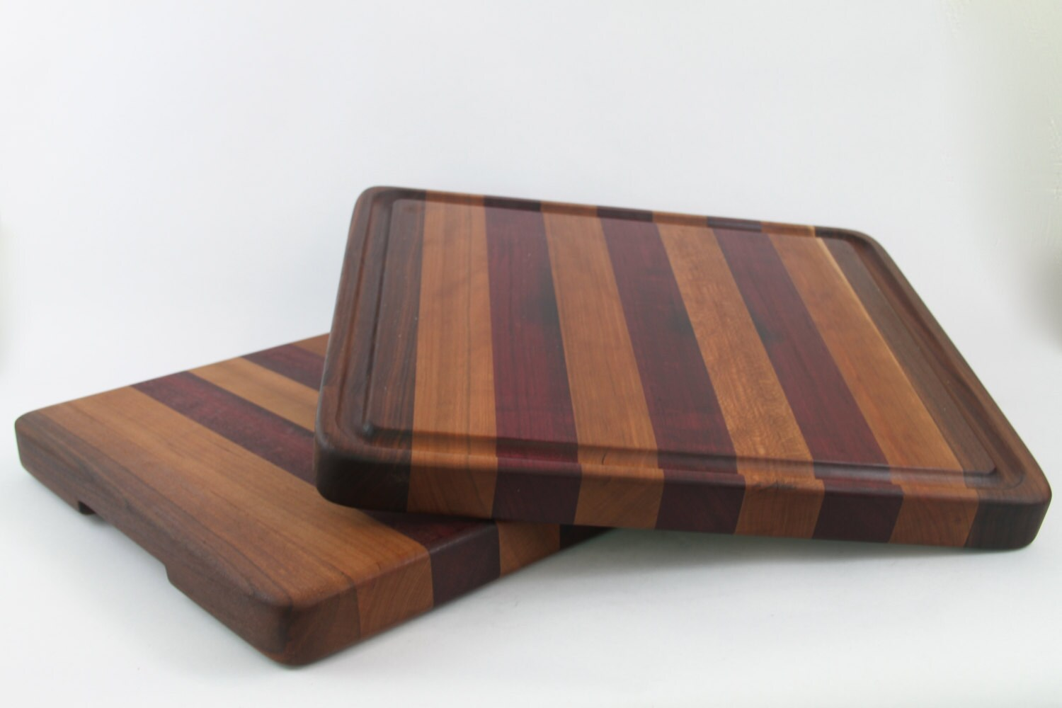 Handcrafted wood cutting board edge grain cherry purple