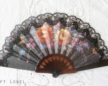 Hand Fan, featuring bright colored flowers and black lace edges