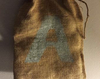 Burlap bag with the letter A in blue