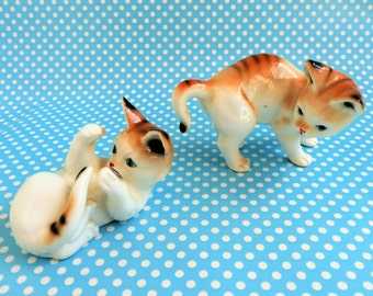 A pair of bone china playful kitten figurines from the 1960s