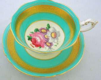 Paragon gold etch large pink rose center turquoise Tea cup and saucer antique pastel english