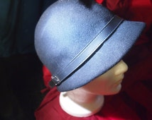 Vintage 1920's style black hat with greyish colored accent piece