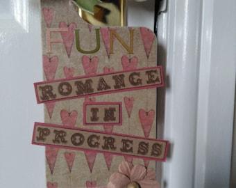 Romance in progress door hanger, mum & dads room