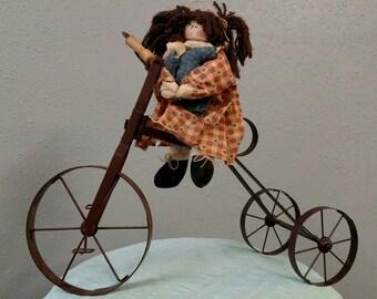 Rag Doll on Vintage-Style Bike