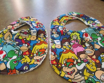 bib baby, mario bross double protein 2 size 0-12 months and 12 to 24 months available