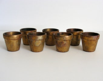 7 Bronze-Painted Candle holders