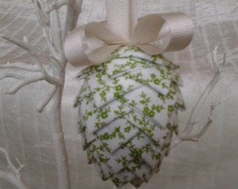 Fabric hanging pine cone in green and white ditsy floral design