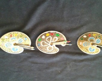 """Three vintage painter's palette brooches. Circa 1960""""s."""