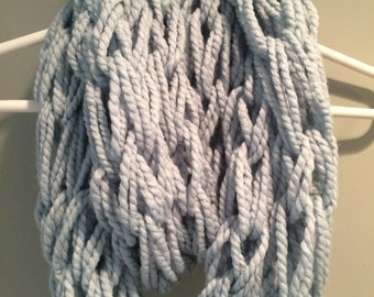 Blue hand knitted infinity scarf