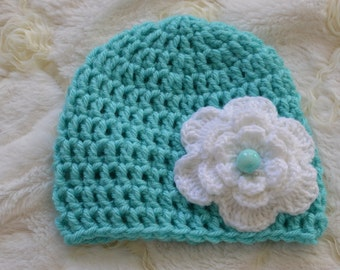 Newborn baby hat.  Turquoise crochet hat with white flower. Crochet baby hat