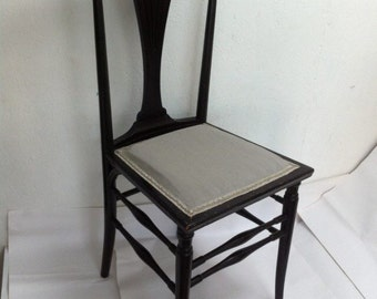 Vintage wooden reupholstered chair
