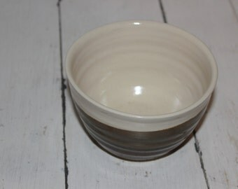 white and red brown ceramic cereal bowl