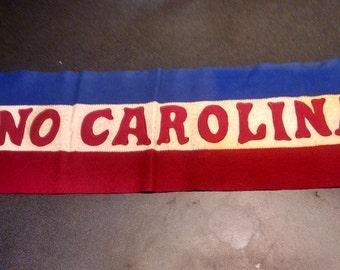 "Vintage ""No Carolina"" banner"