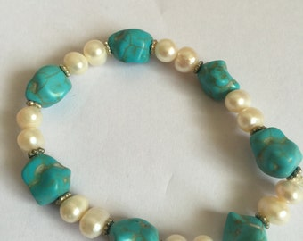 Blue stone with white pearl