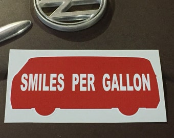 Smiles per Gallon window decal bumper sticker.  2.75 X 6 inches.