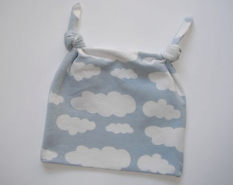 Blue baby hat with white clouds. Made from organic cotton jersey knit (size 0-6 months)