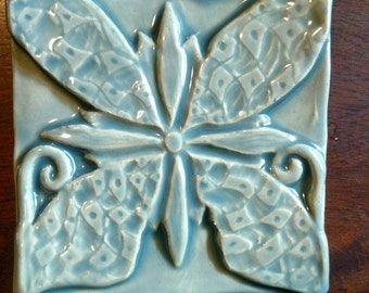 Blossoming Peace: handmade butterfly and flower tiles.