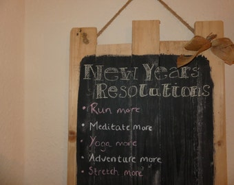 Reclaimed rustic wooden chalk board with hessian rope and chalk