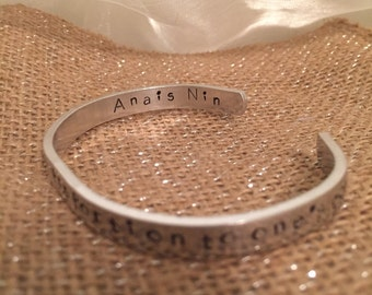 "Anais Nin quote ""Life shrinks or expands in proportion to one's courage"" silvertone cuff bracelet 6"" x 1/4"" hypoallergenic"