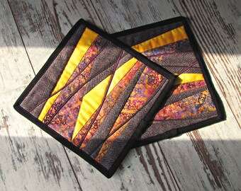 "Set of two hot pads patchwork from the series ""Autumn tundra""."
